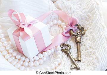 gift box and keys with pearl jewellery and lace