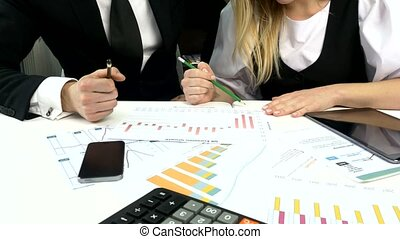 Business peoples developing a business project and analyzing...