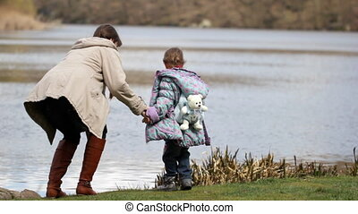 Mother and daughter near the river