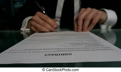 Business people signing the contract to conclude a deal -...