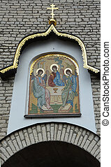 "PSKOV, RUSSIA - MARCH 08: Mosaic gate icon ""Old Testament Trinity"" designed by E. Klimov and made in 1942 in Germany, was established in 2003 above Pskov Kremlin gate in March 08, 2015"