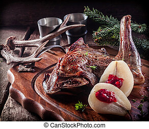 Roasted Vension Haunch Served on Wooden Tray with Prepared...
