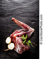Raw Venison Haunch Seasoned with Herbs and Onion - High...