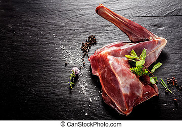 Raw Venison Haunch Seasoned with Herbs and Spices - High...