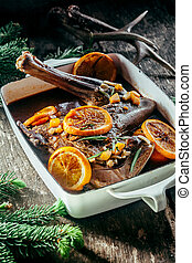 Roasted Venison Haunch in Pan with Citrus Slices - Roasted...