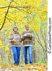 Senior couple resting - Cute senior couple resting in autumn...