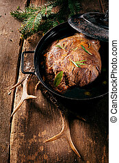 Venison Roast in Pot Seasoned with Fresh Herbs - High Angle...