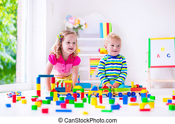 Kids playing at day care - Kids play at day care Two toddler...