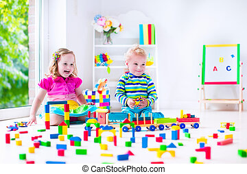 Kids playing at day care with wooden toys - Kids play at day...