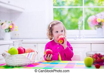 Little girl having fruit for breakfast