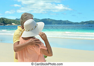 elderly couple walking along the seashore - Beautiful happy...