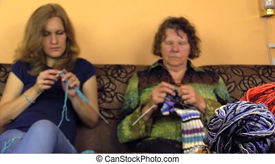 knitters and wool balls - Old grandmother and young woman...