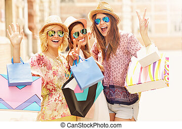 Group of happy friends shopping in the city - A picture of a...