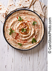 Classic hummus and pita bread. vertical top view - Classic...