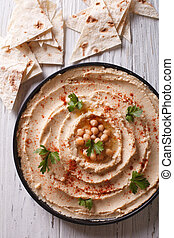 Classic hummus close-up and pita vertical top view - Classic...