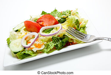 Tossed salad on a plate on a white background - tossed salad...