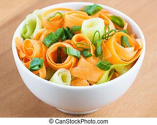 Fresh carrot salad in bowl