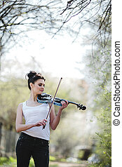 beautiful girl with a violin in his hands