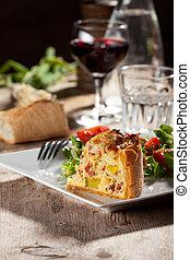 fresh quiche lorraine on a wooden board