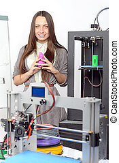 Beautiful girl with three-dimensional printer - Beautiful...