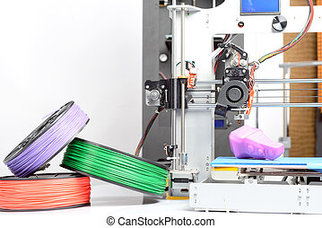 Photo of a three-dimensional printer - Close up photo of a...