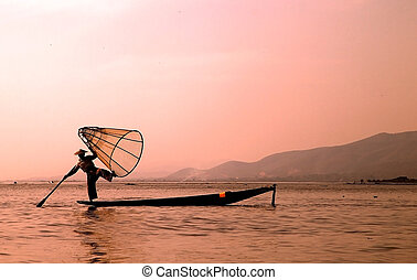 Inle Lake - Leg fishing on the Inle Lake at the sunset,...