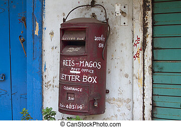 Traditional red old Indian mailbox. India Goa.