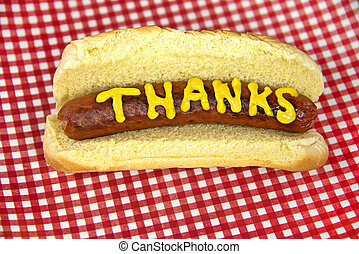 thanks on hot dog - Mustard thanks on a hot dog in a bun on...