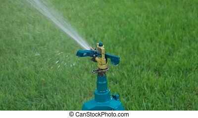 Grden sprinkler working slowmo footage