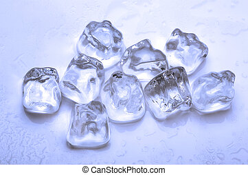 ice cubes - group of ice cubes with melted water around