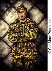 ammunition - Masculine soldier in camouflage. Military, war.