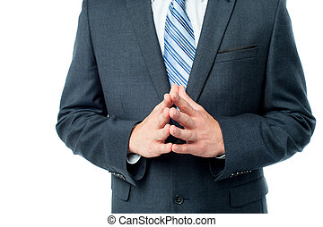 Clasped hands of businessman - Cropped image of businessman...