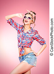 womanly - Pretty pin-up girl alluring in shorts and shirt...