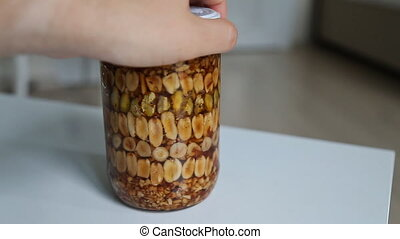 Honey with nuts In rotates in a glass jar - Honey with nuts...