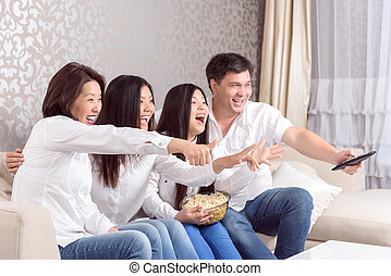 Family home at TV watching films - Emotional moment Asian...