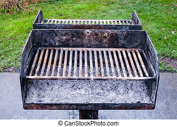 Dirty metal barbecue grill with ashes.