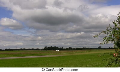 Small aircraft landed in the field - Small private airplane...