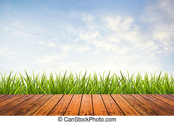 green grass with sky and wood floor