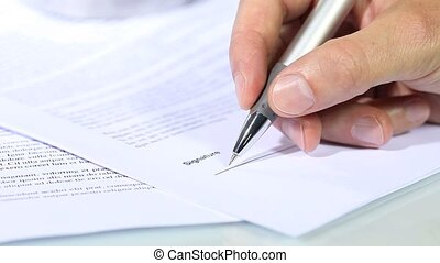 hand signing a document, signature concept