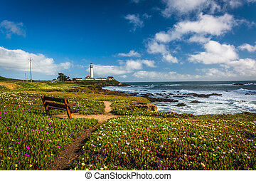 Bench and view of Piegon Point Lighthouse in Pescadero,...