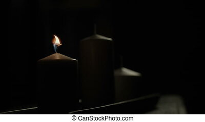 Candle being blown out in darkness - White candle in church...
