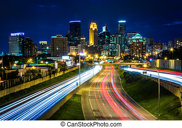 I-35 and the skyline at night, seen from the 24th Street...
