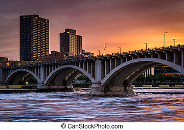The Central Avenue Bridge and Mississippi River at sunset, in Minneapolis, Minnesota.