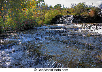 water flowing over rocks - water flowing on a early fall day...
