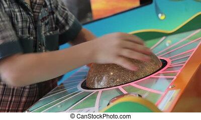 A young boy playing game machine, HD