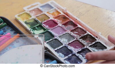 Paint-box, watercolor paints palette, brush