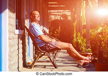 man in chair - man relaxed and enjoy in chair at the sunny...