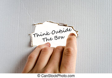 Think outside the box concept - Hand and text on the...