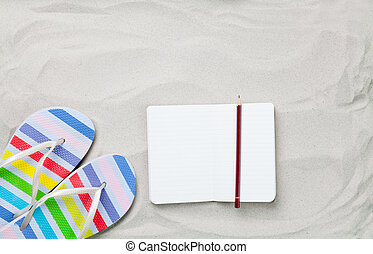flip flops and classic notebook with pencil on white sand...