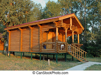 The wooden house with a porch. - The wooden house...